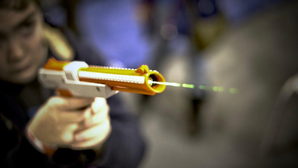 Boy firing laser gun